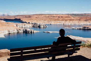 Sitting man enjoying the scenery of Lake Powell