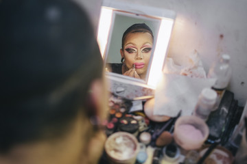 Mirror Reflection of Drag Queen Transformation Putting on Make Up
