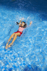 happy asian kids in swimming pool
