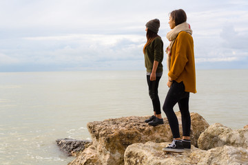 Two Female Friends looking the ocean