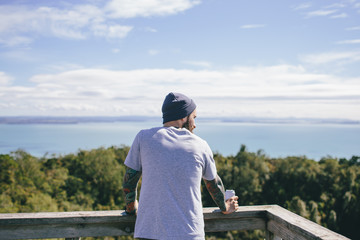 Hipster man on a view point from behind