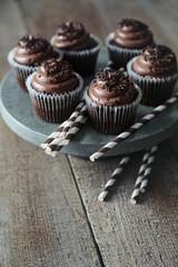 Chocolate cupcakes and straws