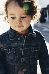Young fashionable toddler wearing a jean jacket