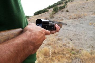 Close up of a hunter with his shotgun