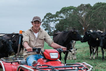 Young Dairy Farmer sitting on ATV