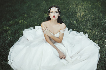 Portrait of a beautiful bride in a romantic wedding dress