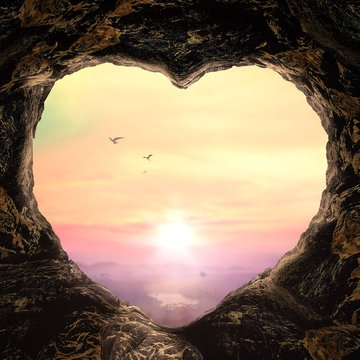 World environment day concept: Heart shape of cave on autumn sunset background