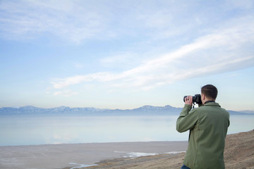 male takes photos over the great salt lake