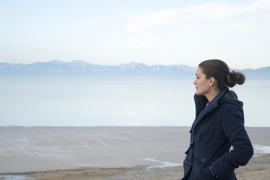 female on antelope island in utah looking out over the great salt lake and salt flats.
