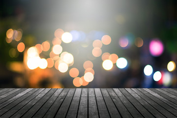 image of wood table and blurred bokeh background with colorful lights .