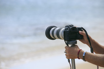 Photographer making a photo on the sea