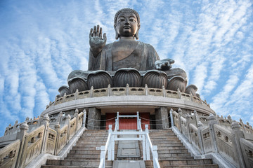 Giant Buddha Po Lin Monastery at Lantau Island in Hong Kong with blue sky