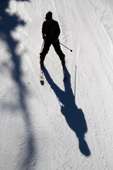 Person skiing on long shadow