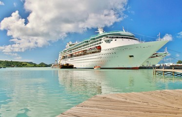 A cruise ship docked  on the tropical island of St. Johns, Antigua