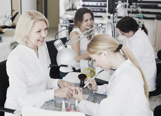 Two clients doing manicure