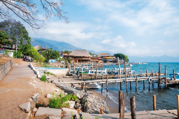 The small village of Panajachel on the shore of  Lake Atitlan in Guatemala. Tourist boats at the docks are used for the tour of the lake.