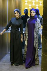 Two beautiful Muslim women in the elevator