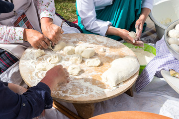 Preparation of a traditional Turkish yufka for pastries - gozleme by hands of a women. ISTANBUL,TURKEY - May 13, 2017