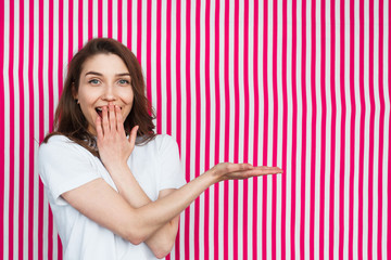 Excited woman posing on striped background