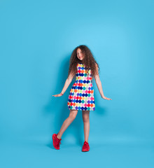 Trendy hipster girl in colorful dress