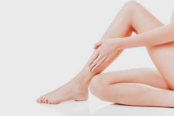 Women's feet on white background.