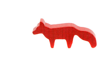 Small wooden red fox toy isolated on white