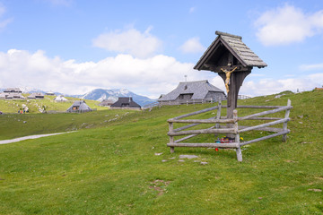 Velika planina plateau, Slovenia, Mountain village in Alps, wooden houses in traditional style, popular hiking destination