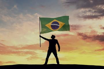 Male silhouette figure waving Brazil flag. 3D Rendering