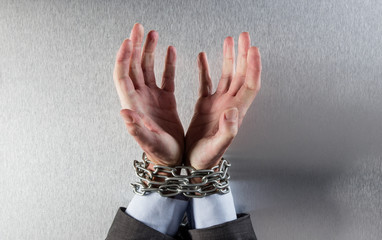desperate man hands tied with chain begging for employee victim