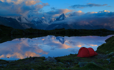 Fotomurales - Red tent at Lac des Cheserys in the mountains near Chamonix during dusk. Chamonix, France