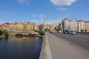 Jiraskow Bridge leading to the Dancing House in Prague, Czech Republic