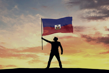 Male silhouette figure waving Haiti flag. 3D Rendering