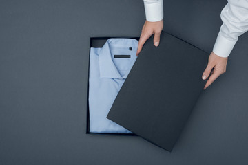 tailor with shirt in box