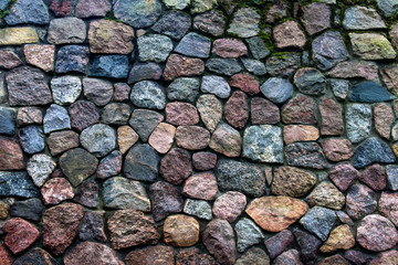 Texture of an ancient stone wall made of separate big stones. Decorative, architectural element.
