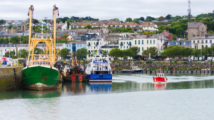 Howth harbor in Ireland, colorful fishing boats