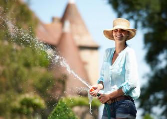 Woman watering the garden