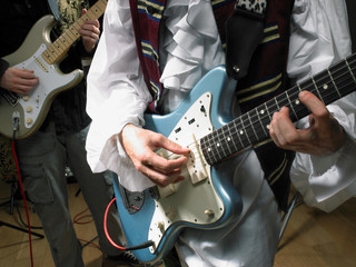Two electric guitar players