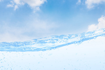 Wave of drinking water and bubble air white sky background.