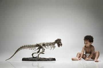 Boy and a dinosaur skeleton
