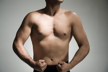 Man flexing his torso