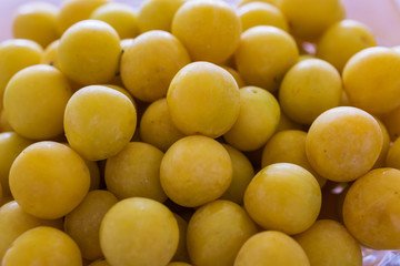 Close up of a bunch of ripe yellow plums. Concept Healthy Eating.