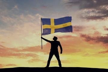 Male silhouette figure waving Sweden flag. 3D Rendering