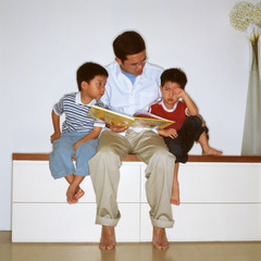 Father reading with sons