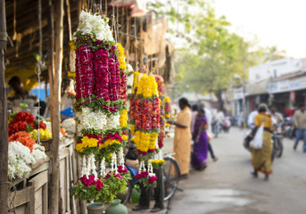 Traditional indian marigold flower garlands in a market place