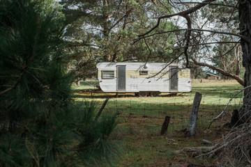 Old Retro Caravan parked in Bushland