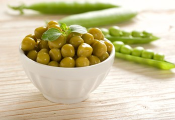 canned peas on wooden background