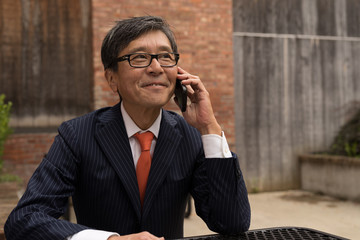 Asian businessman talking on a cell phone