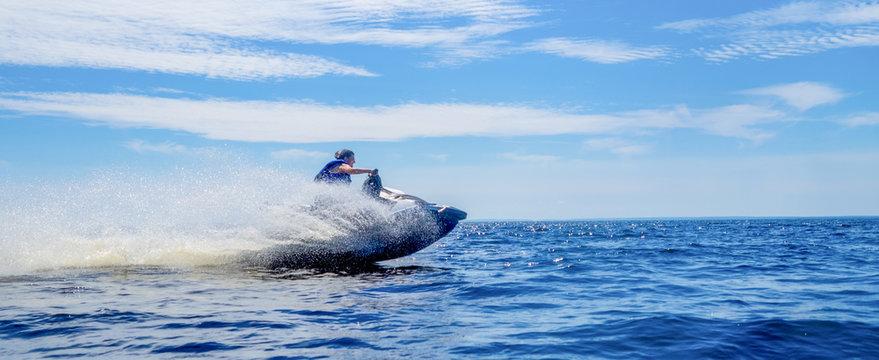 Woman riding jet ski on lake in summer