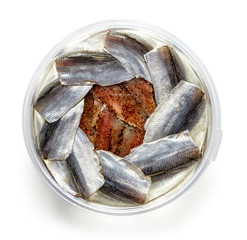 Bowl of anchovy fillets isolated on white, from above