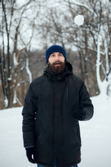 bearded man in winter hat smiling portrait extreme